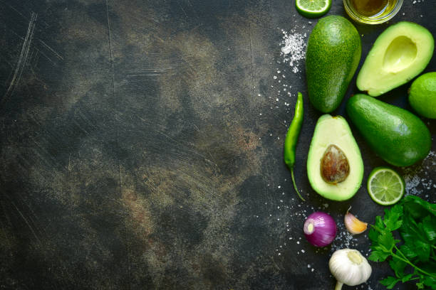ingredients for making traditional mexican dip guacamole - mexican food stock photos and pictures