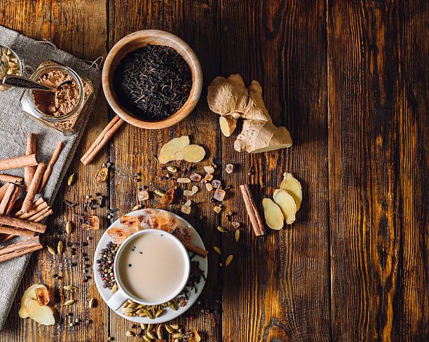 ingredients for masala chai and cup with beverage - darjeeling tee stock-fotos und bilder