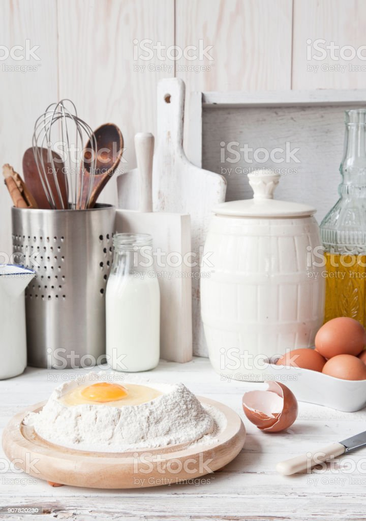 Ingredients for pancakes. Close-up, selective focus. White vintage wooden background. stock photo