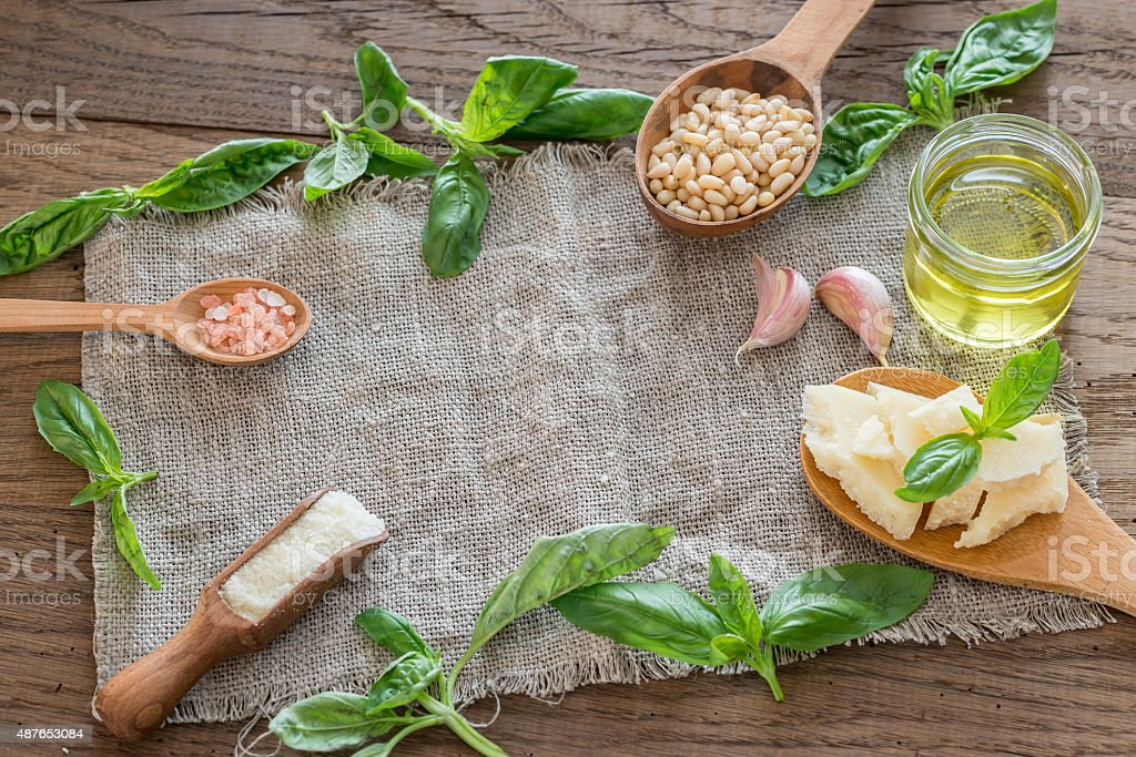 Ingredients for pesto on the wooden table stock photo