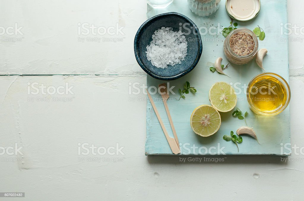 Ingredients for salad dressing on a white and blue background stock photo