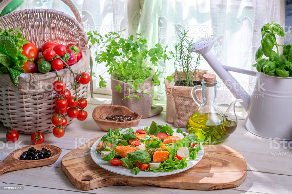 Ingredients for salad with salmon and vegetables stock photo