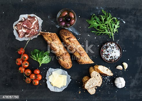 istock Ingredients for sandwich with smoked meat, baguette, basil, arugula, olives 478287750