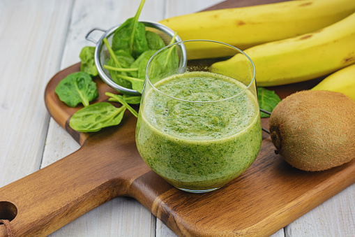istock Ingredients for smoothies: spinach, banana, kiwi 585318996