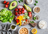 istock Ingredients for spring vegetable buddha bowl. Delicious healthy food.  On a gray background, top view 656873420