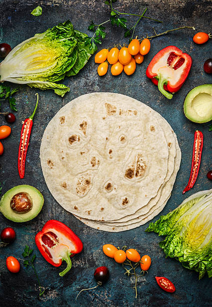 ingredients for tacos or burrito making. - tortilla stock photos and pictures