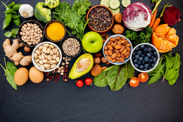 Ingredients for the healthy foods selection. The concept of healthy food set up on dark stone background. Ingredients for the healthy foods selection. The concept of healthy food set up on dark stone background. vegetarian stock pictures, royalty-free photos & images