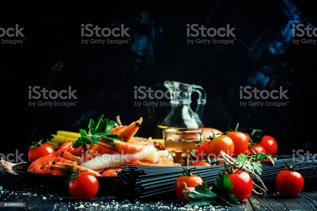 Ingredients for the preparation black pasta with seafood stock photo