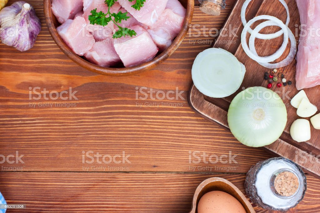 Ingredients for the preparation of minced meat for cutlets from turkey fillet, top view royalty-free stock photo