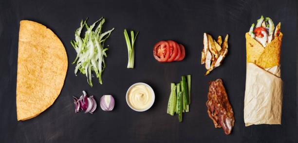 zutaten für verpackte sandwich - veggie wraps stock-fotos und bilder