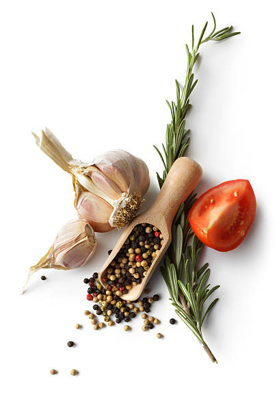 ingredients: garlic, pepper, rosemary and tomato - pepper seasoning stock photos and pictures