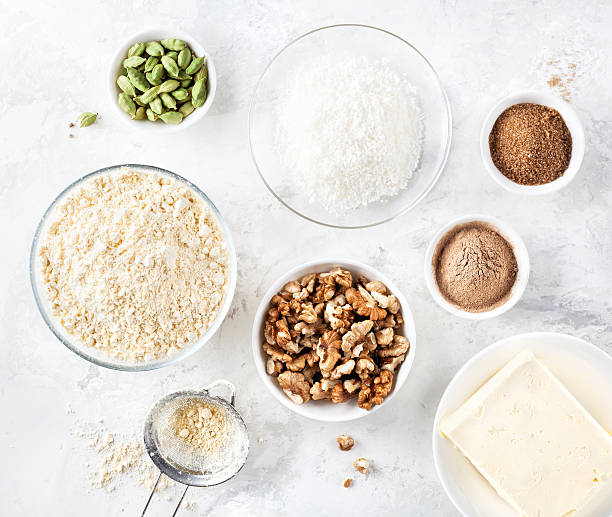 Ingredients of Indian sweets Besan Ladoo stock photo