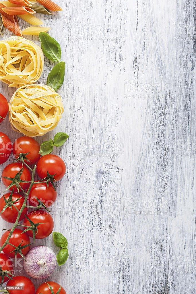 ingredients pasta tomatoes basil frame on white wooden backgroun stock photo