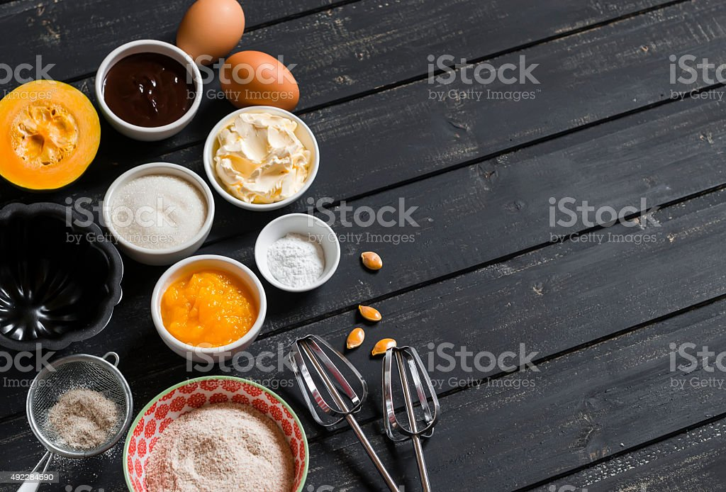 Ingredients to prepare pumpkin cake with chocolate stock photo