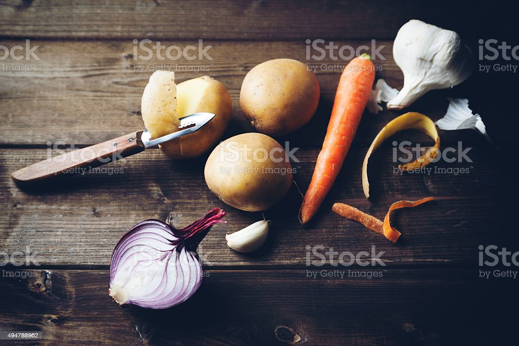 ingredients with potato carrot onion and garlic stock photo
