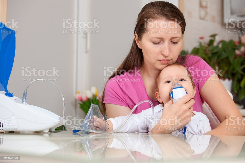 inhalation child makes baby mama stock photo