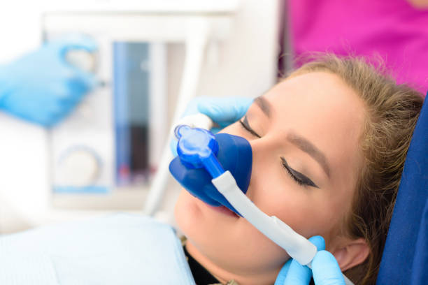 Inhalation Sedation at Clinic Beautiful getting woman inhalation sedation at dental clinic dental health stock pictures, royalty-free photos & images