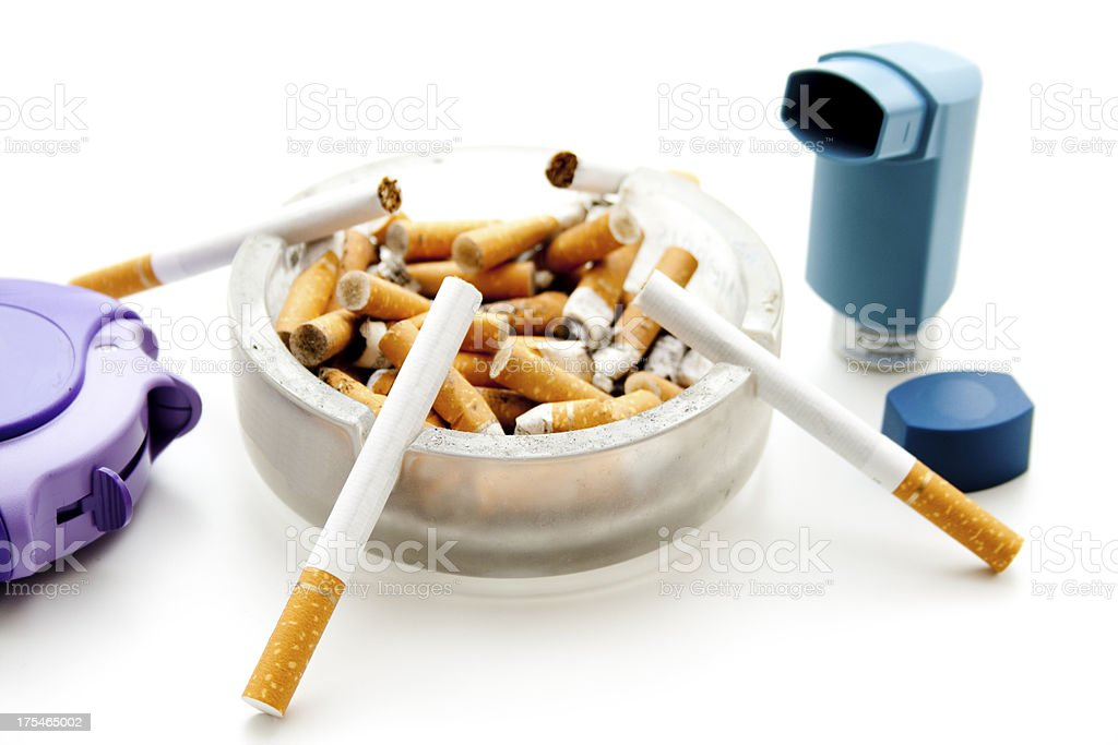 Inhaler with cigarets and ashtray royalty-free stock photo