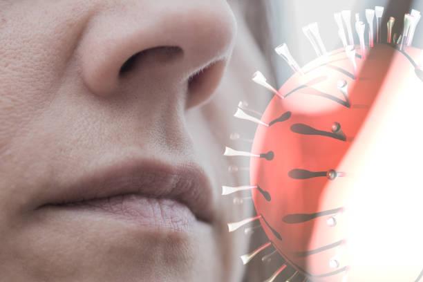 inhaling virus through airborne transmission stock photo