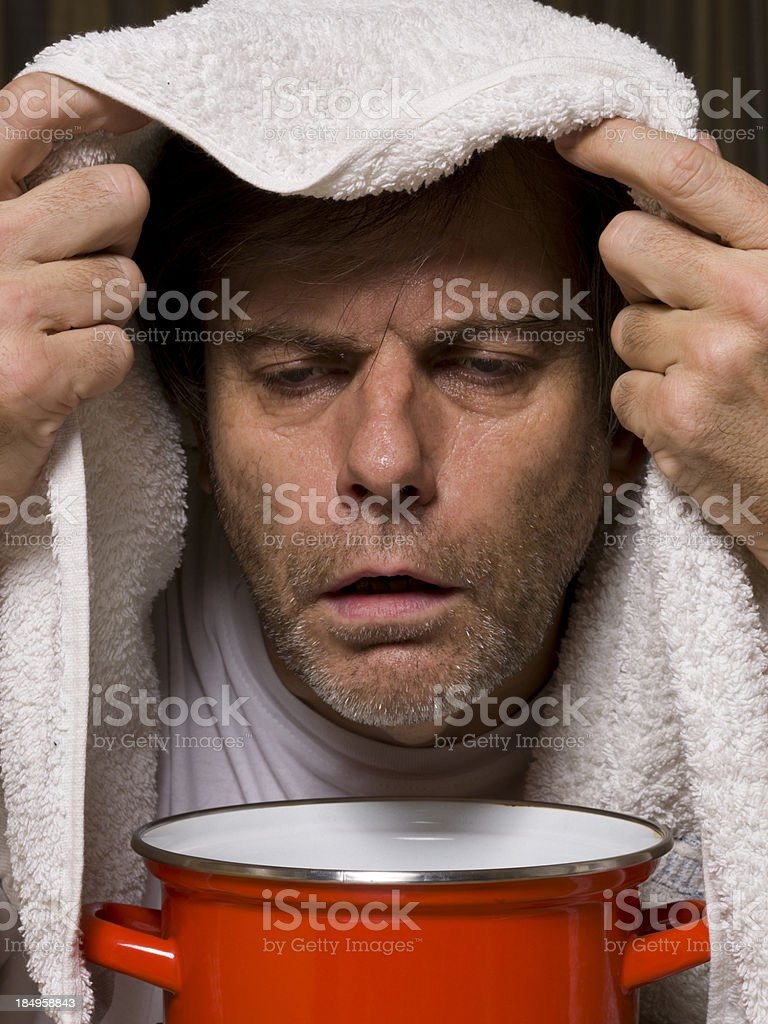 Inhaling with herbs royalty-free stock photo