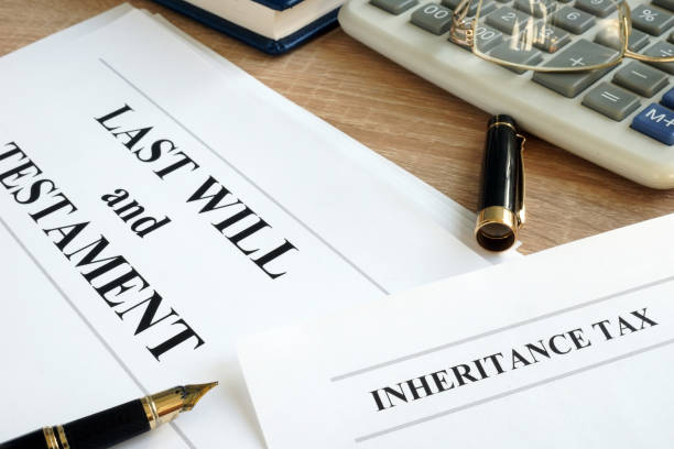 Inheritance tax and last will and testament on a desk. stock photo