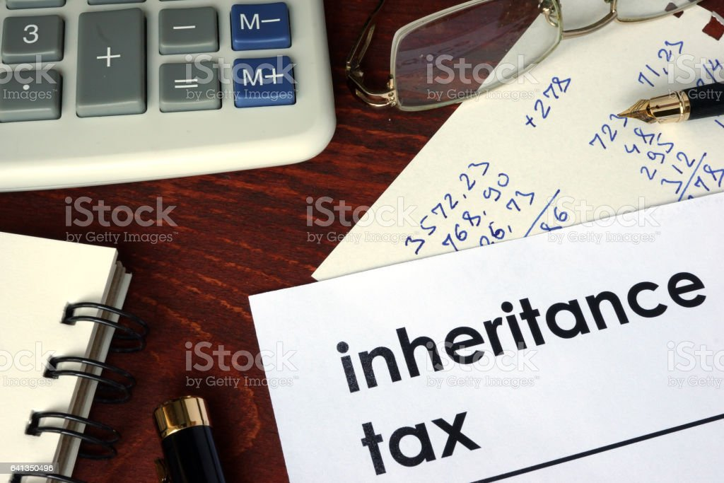 Inheritance tax written on a paper. Financial concept. stock photo