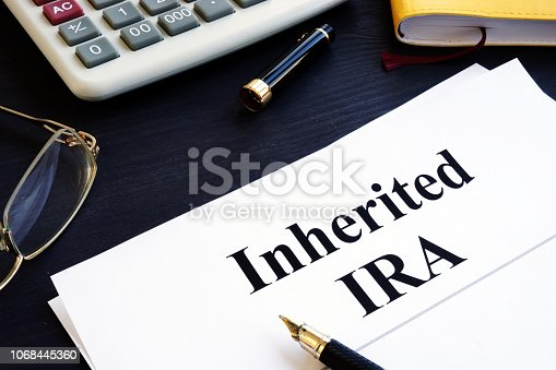 Inherited IRA documents on a table. Retirement plan.