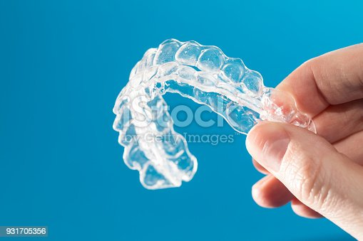 istock Inivisalign braces or invisible orthodontic aligner. 931705356