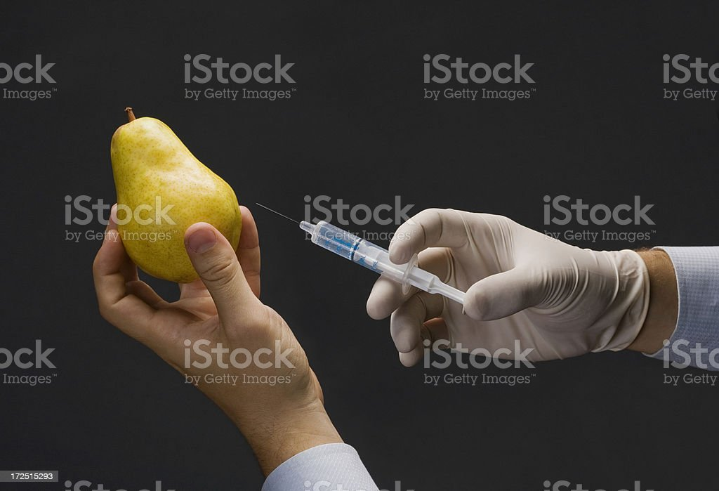 Injecting a Pear royalty-free stock photo