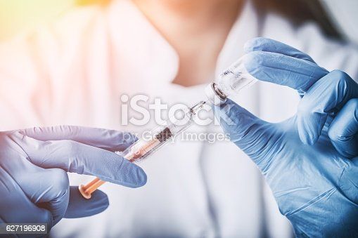 627196908 istock photo injecting injection vaccine vaccination medicine flu woman docto 627196908