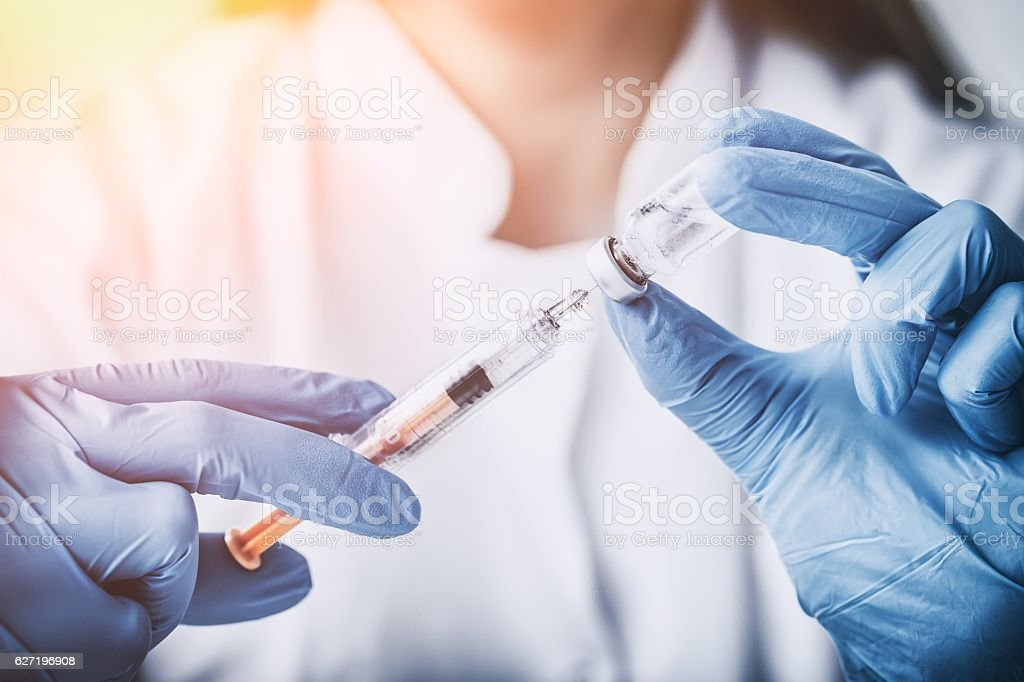 injecting injection vaccine vaccination medicine flu woman docto - foto de stock