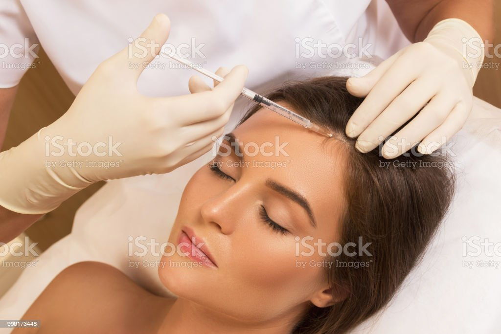 Injection for hair growth stock photo