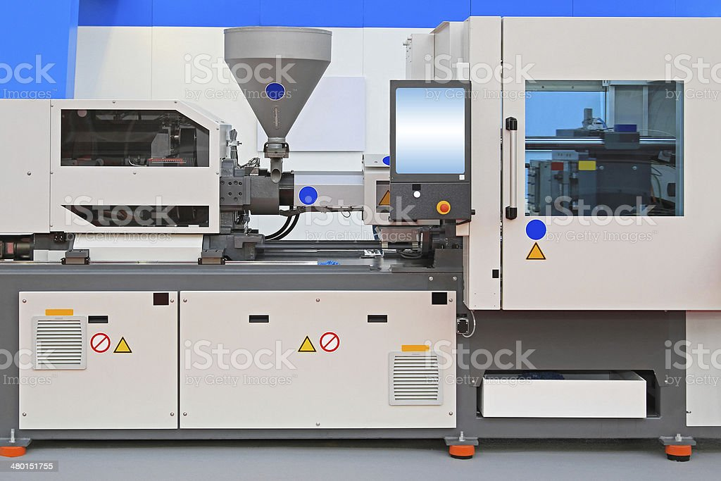 Injection molding machine stock photo