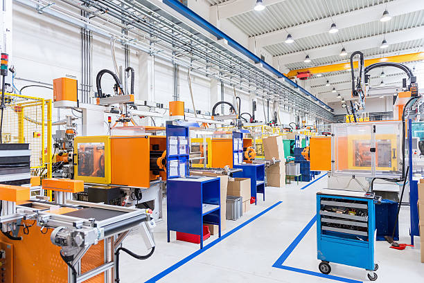 injection moulding modern machines in factory - metal robot in logistic factory foto e immagini stock