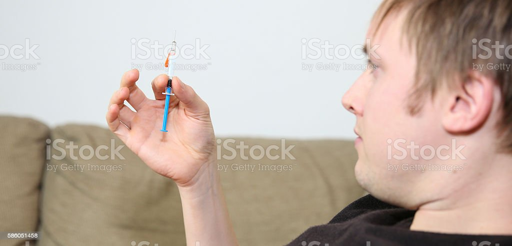 Injection of anti coagulant to prevent blood clots after accident stock photo