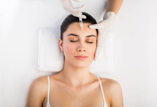 Injection on latin woman's face stock photo