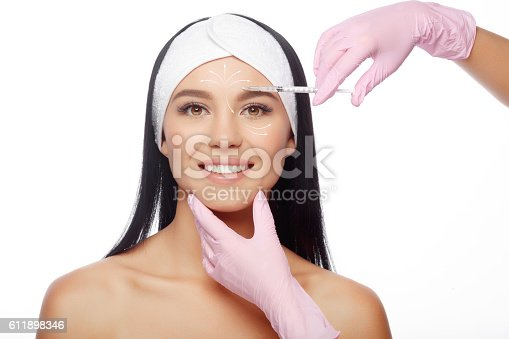 istock Injections of anti-aging facial 611898346