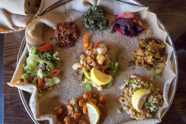 injera and toppings - eritrea stock photos and pictures