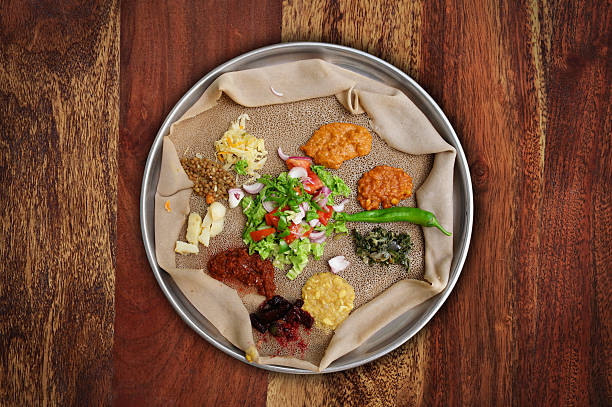 injera meal - somalia stock photos and pictures