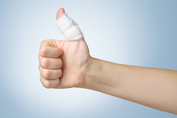 injured finger with bandage - thumb stock photos and pictures