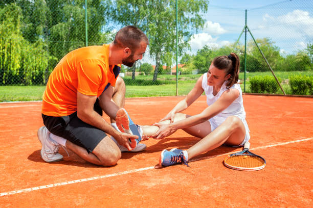 Injured girl on the tennis court stock photo