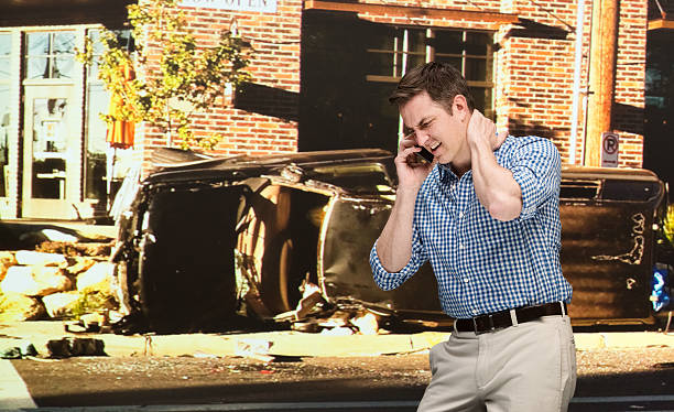 Injured man at car crash scene stock photo