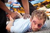istock Injured man being forced down and arrested 155428549