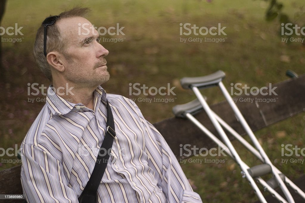 Injured man deep in thought royalty-free stock photo