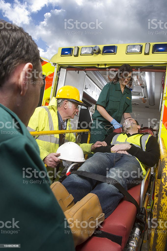 Injured man loaded into ambulance royalty-free stock photo