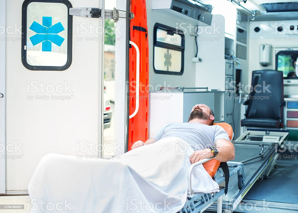 Injured man on the stretcher stock photo