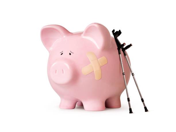 Injured piggy bank isolated on white stock photo