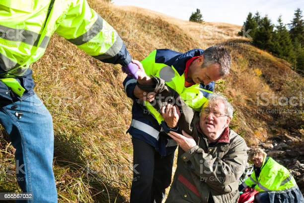 Photo of Injured senior helped by Swiss mountain rescue in river gorge
