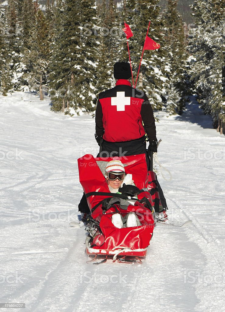 injured skier on sled stock photo