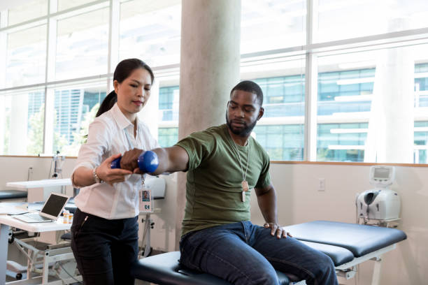 Injured soldier in physical therapy stock photo